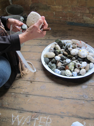 Performance and public engagement with Kerry Morrison for Not a Drop.  Thames River stones gathered and trundled through the streets of London to a place where the public wrote their personal messages to the river onto dissolving paper, and attached them to river stones, which were then returned to the water.